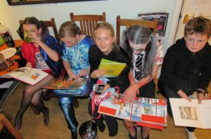 Amelia reading with friends
