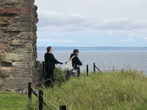 The young people admiring the view from Tantallon Castle.