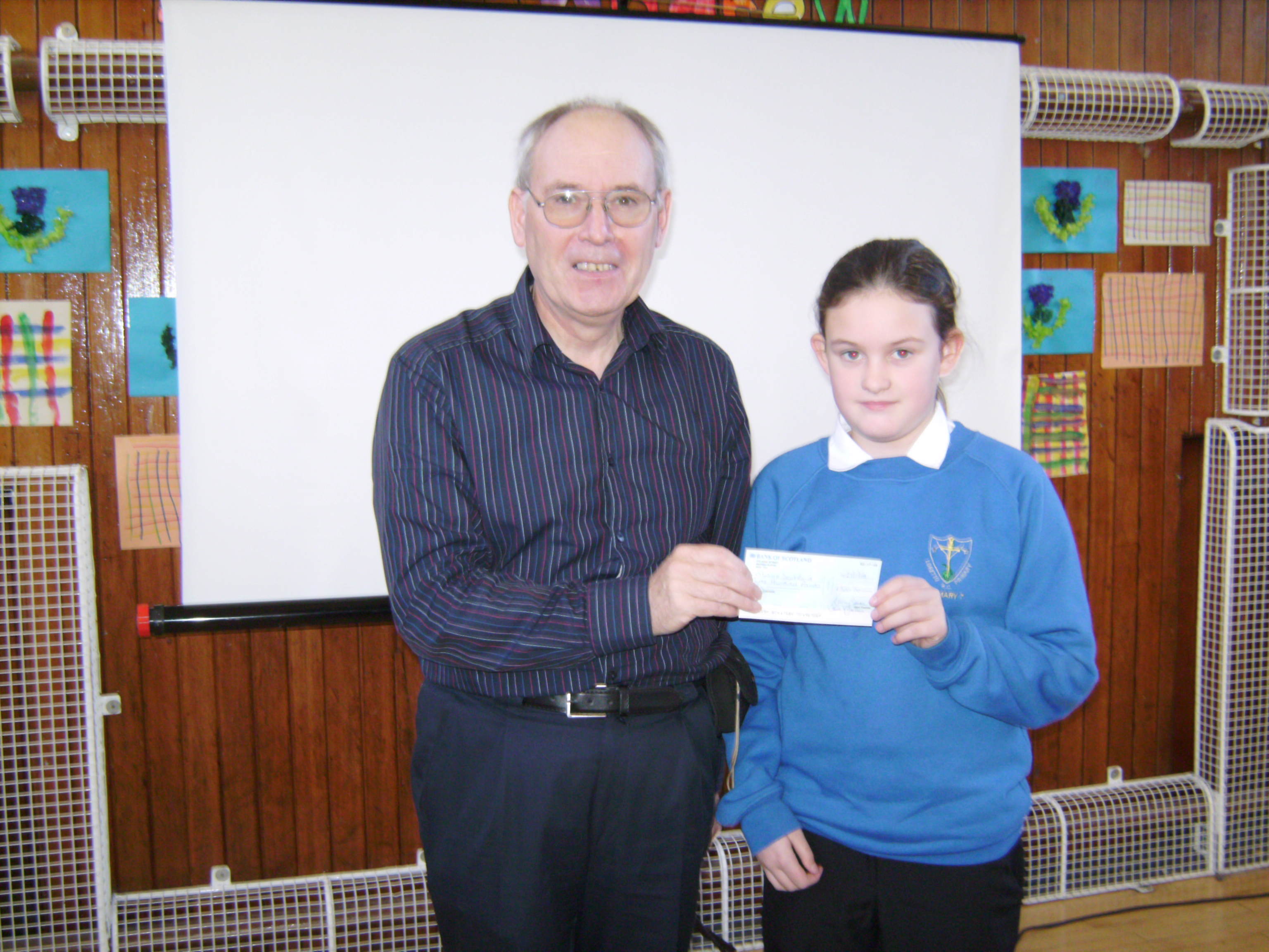 Handing over our cheque