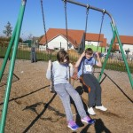 Chris and Natasha chatting on the swings