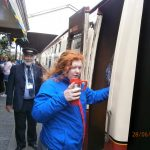 Emily boarding the train
