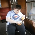Danny enjoying lunch on the train