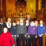 Fr. Jim Smith with children from the four schools who took part in the liturgy. Arran (p4 -front 2nd from the right) read a bidding prayer.